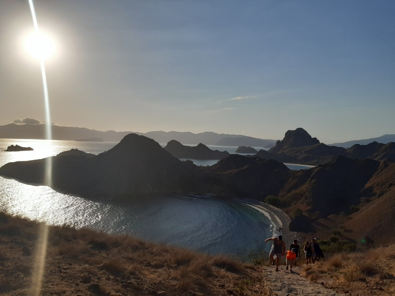 Padar Island in Komodo National Park at sunset there 3 different coloured beaches visible pink black and white