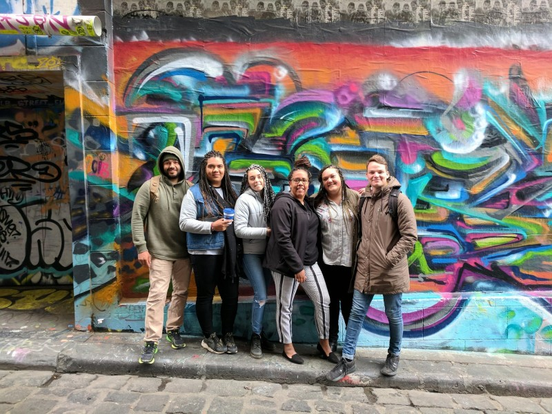 Australian volunteers on their return walkshop in Hosier Lane Melbourne Clinton Wilson Dimity Shillingsworth Leilani Knight Alkira Edwards Jemma Milly and Cameron Balcomnbe