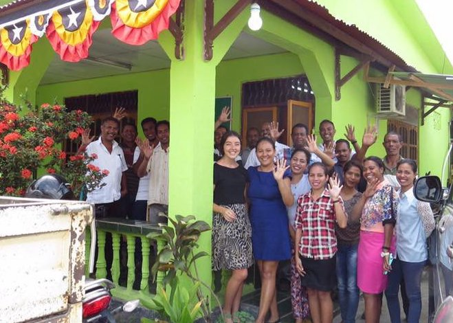 Australian volunteer Sophie Rayner with colleagues at RABIA outside the organisations headquarters in Timor Leste.