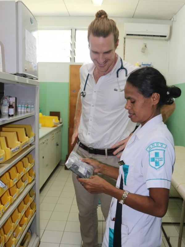 Australian volunteer Sam Brophy Williams checking chemotherapy drugs with a colleague in Timor Leste